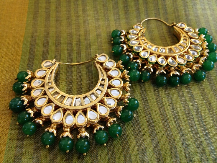 Earrings to die for (gold-plated and studded with glass and peacock green stones)
