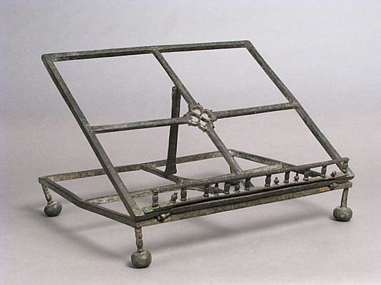 I love this folding lectern.  Lectern    Date:      15th–16th century  Geography:      Made in, Italy or present-day Spain  Culture:      Italian or Catalan  Medium:      Iron  Dimensions:      Overall (raised): 9 7/16 x 14 1/4 x 11 5/8 in. (24 x 36.2 x 29.5 cm) Overall (collapsed): 3 11/16 x 14 1/4 x 11 5/8 in. (9.4 x 36.2 x 29.5 cm)  Classification:      Metalwork-Iron  Credit Line:      The Cloisters Collection, 1947  Accession Number:      47.101.80