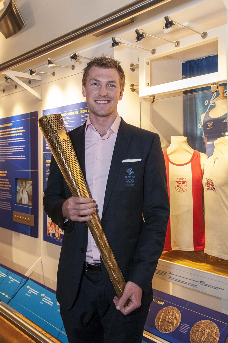 Alex Gregory, Olympic Gold Medal Winner 2012, in the Schwarzenbach International Rowing Gallery with our 2012 torch!