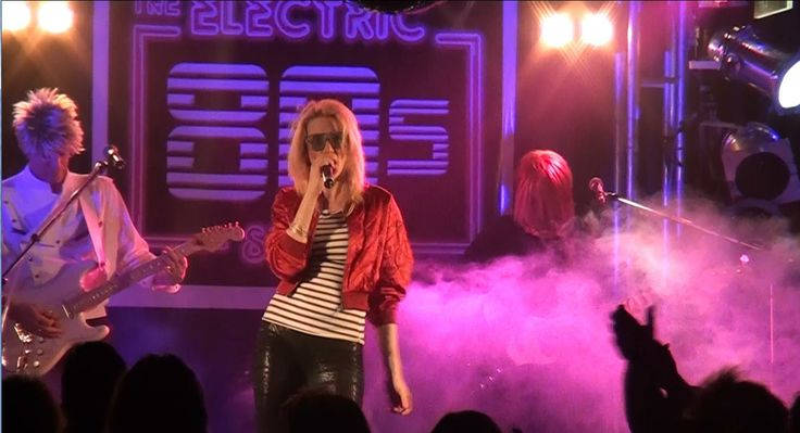 Lead singer Porsche rocking her Kim Wilde outfit for Kids in America. Electric 80s Show