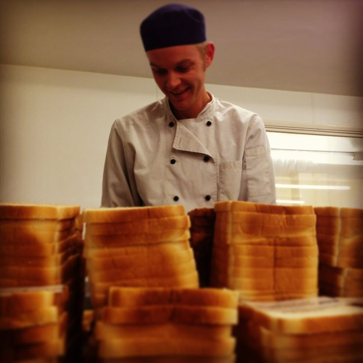Chef Dave getting stuck into a moutain of sandwiches!