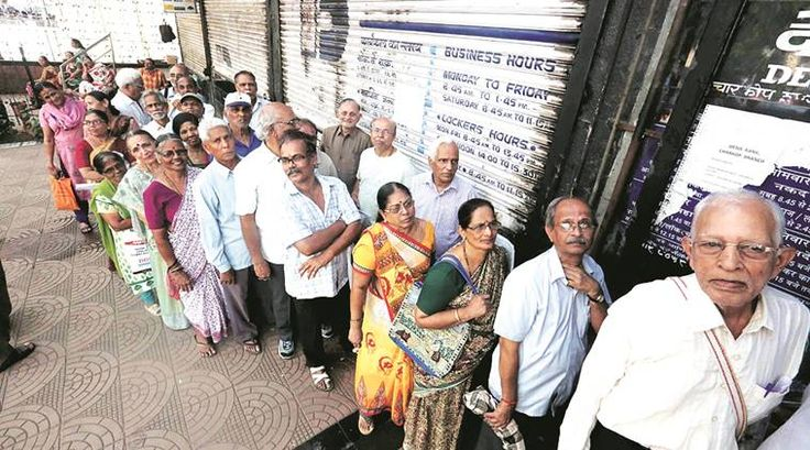 People in Queues for new Currency