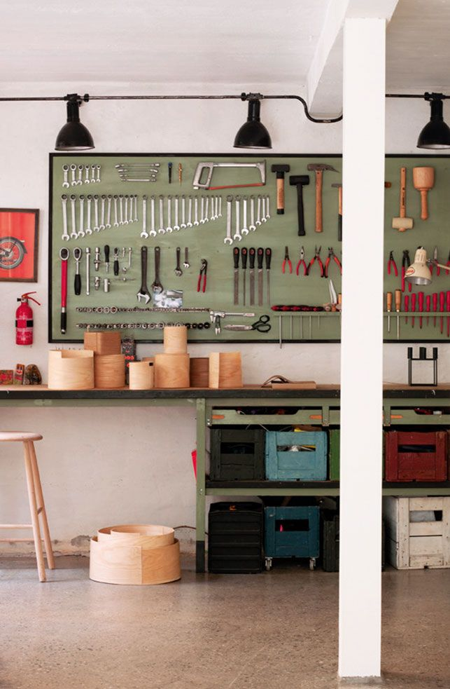 My kinda workshop!  Love the crisp black accents and the organized tools against a sage green board.
