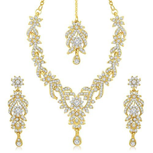 This Sukkhi Trendy Gold Plated Australian Diamond Stone Studded Necklace Set Is Made Of Zinc Women love jewellery; specially artificial jewellery adore a women. They wear it on different occasion. They have special importance on ring ceremony, wedding and festive time. They can also wear it on regular basis . Make your moment memorable with this range. This jewellery features a unique one of a kind traditional embellish with antique finish. Stone: Australian Diamond