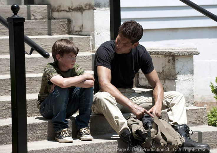 "Carl Grimes (Chandler Riggs) and Shane Walsh (Jon Bernthal) in Episode 201, ""What Lies Ahead"""