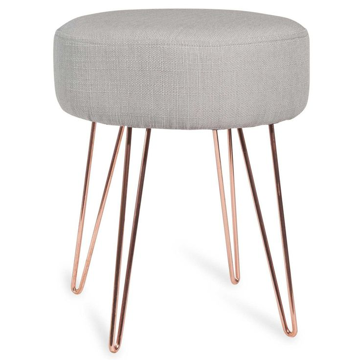 Note the contrast between the sleek copper legs and Scandinavian-style grey upholstery