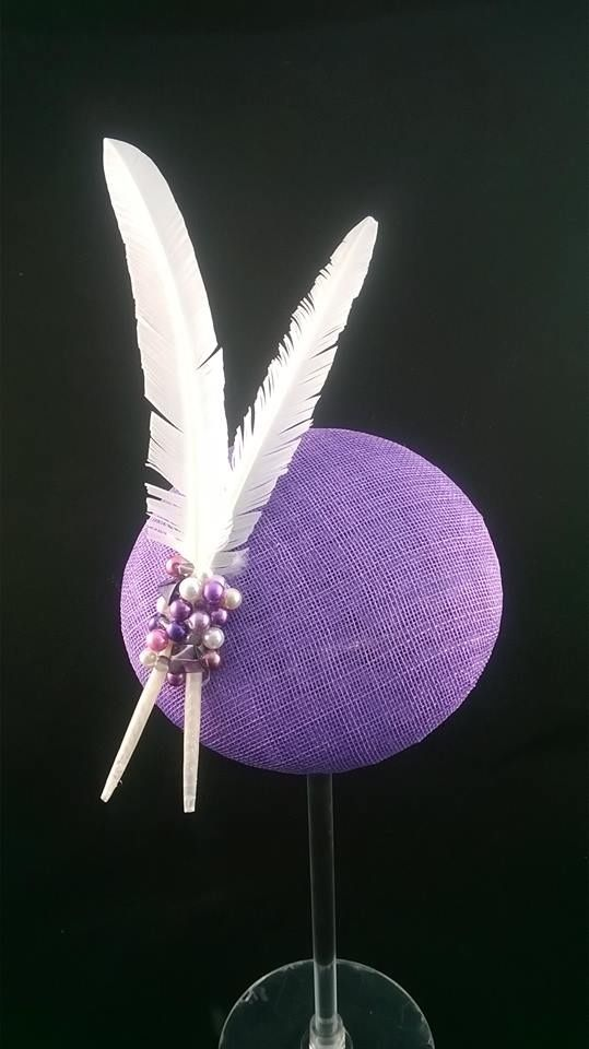 Lavender button headpiece with white feather duo held in place with a bead cluster
