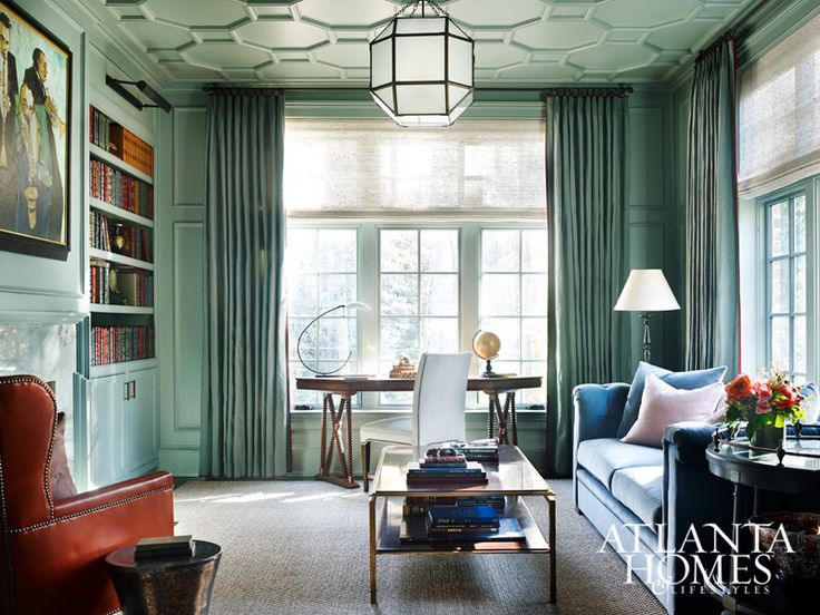Tone-on-tone elements give the study a classic look. Millner paired a luxe Kneedler Fauchère fabric with a Conrad shade to dress up the windows. The coffee table, desk and seating are from Hickory Chair.