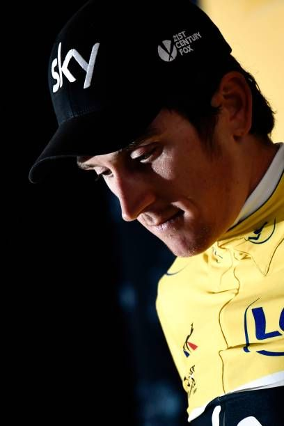 Great Britain's Geraint Thomas celebrates his overall leader yellow jersey on the podium at the end of a 14 km individual timetrial the first stage...