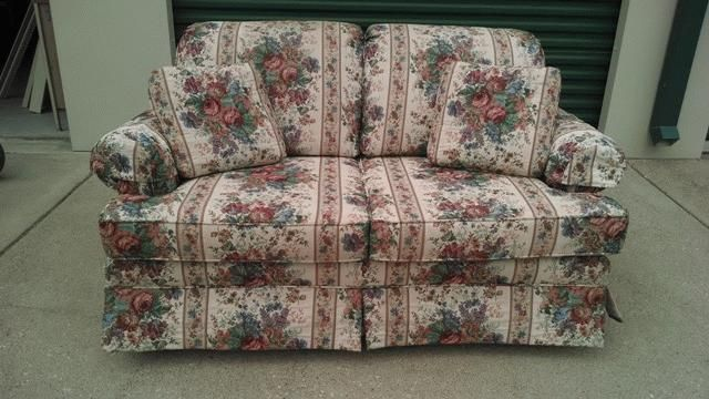 """BEAUTIFUL LOVE SEAT WITH FLORAL TAPESTRY PATTERN 60""""X34.5""""X33""""  THIS ITEM WAS DONATED TO THE TEMPLE COMMUNITY CLINIC AND PROCEEDS FROM THE AUCTION OF THIS ITEM WILL GO TO THE TEMPLE COMMUNITY CLINIC FOR OPERATIONS AND EQUIPMENT.  THIS ITEM AS DONATED BY FORREST AND SANDEE MIDDLETON"""