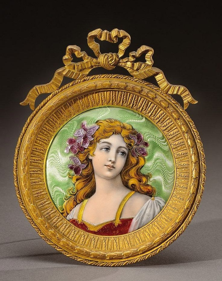 THEOPHILE SOYER, A medallion framed in gilded bronze holding an enamelled copper plate decorated with a woman and mauve iris.  Circa 1890-1900.  H : 6 in Diam : 5 in (with frame)