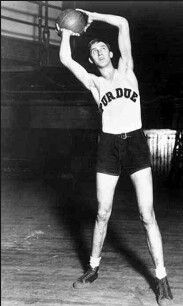 Charles Murphy played competitive basketball at Marion High School (1922–26), located in Marion, Indiana. The All-State player led his school to the Indiana state championship in 1926 during his senior year. He was recruited by men's head coach, Ward Lambert, at Purdue University, where he played for four seasons (1926–1930). Teaming with fellow Hall of Famer John Wooden and co-captain Glen Harmeson, Murphy led the Boilers to the Big 10 championship in 1930 after an undefeated season in…