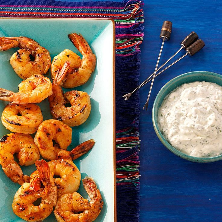 "Grilled Chipotle Shrimp Recipe -""I created this recipe for a Cinco de Mayo party, and it was a hit! It's so easy, yet has a serious 'wow' factor. The creamy dipping sauce mellows out the shrimp's heat perfectly.""—Mandy Rivers, Lexington, South Carolina"