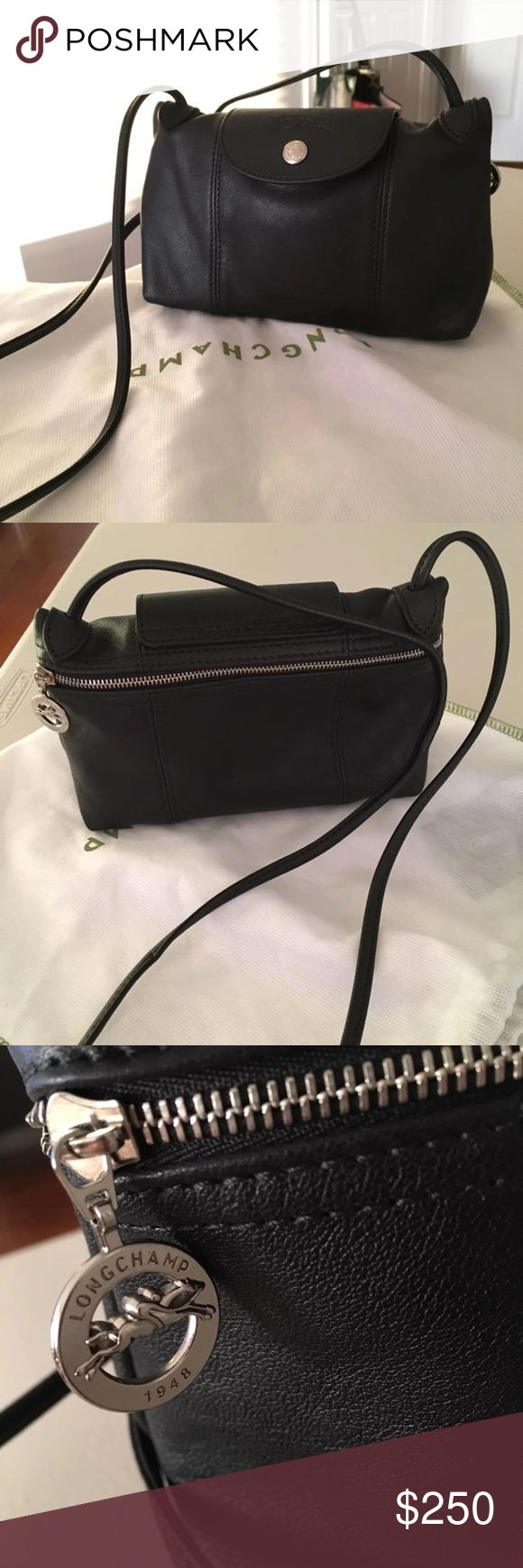 """Longchamp cuir crossbody 8.75"""" x 5.5"""" x 2.85"""". Color: Black. Crossbody mini bag from Longchamp Le Pliage Cuir collection. Small exterior front pocket with snap closure. Final sale. Longchamp Bags Mini Bags"""