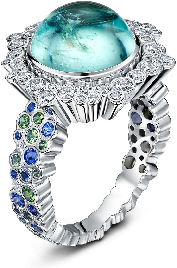 An abundance of lively colour dances through this ring, from an astounding, electric blue cabochon paraiba tourmaline, through a halo of pristine diamonds and a poetic tumble of blue sapphires, tsarvorites, chrome tourmaline, aquamarine and topaz, placed