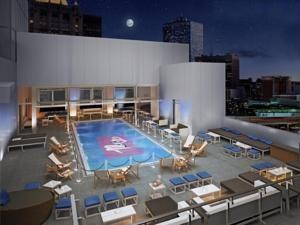 Centrally located in New York City, this 4-star, modern hotel features free Wi-Fi, Exhale Spa and an outdoor, rooftop pool. It is one block from the 28th Street Subway Station. Gansevoort Park Hotel NYC furnishes each room with an iTouch and boasts lofty ceilings. Bathrobes and slippers are provided in the luxury bathrooms. Rooms also include a flat-screen cable TV and a minibar. Ristorante Asellina, which serves Italian specialties, is located at the Hotel Gansevoort Park.