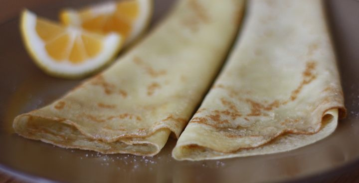 making crepes in advance --layer with wax paper and store in airtight container.  To reheat, remove wax paper , wrap stack in foil and heat for 10-15 minutes in a 350 degree oven