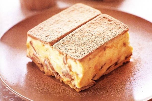 200g packet Tennis Biscuits 3 x 80g Crunchie bars, refrigerated 395g can sweetened condensed milk 600ml thickened cream drinking chocolate, to serve (optional) Method Line a 3cm deep, 26cm x 16cm (...