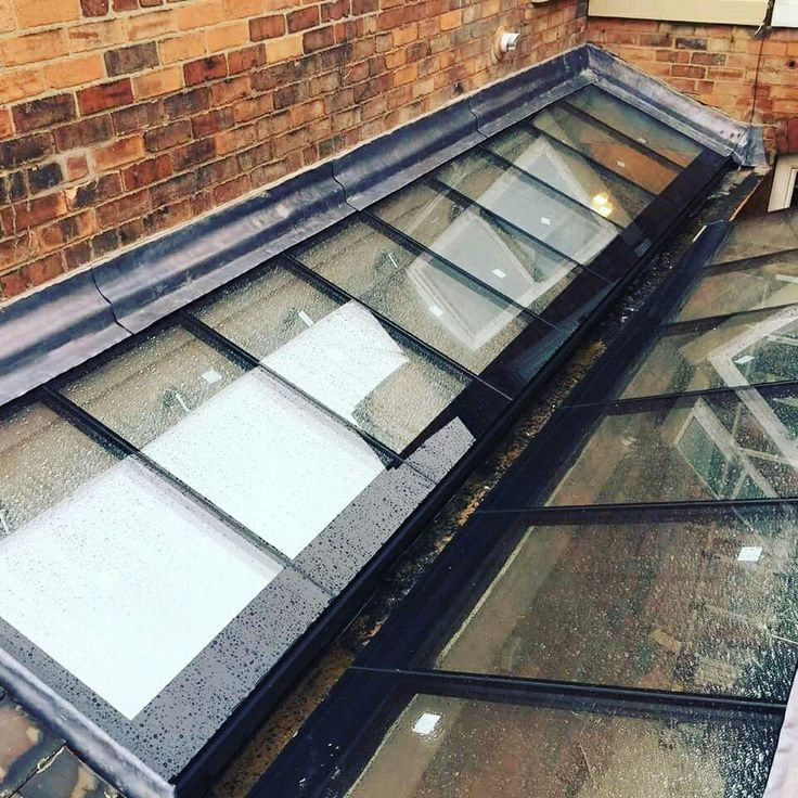 Structurally Bonded Glass And Box Gutter On A Project In