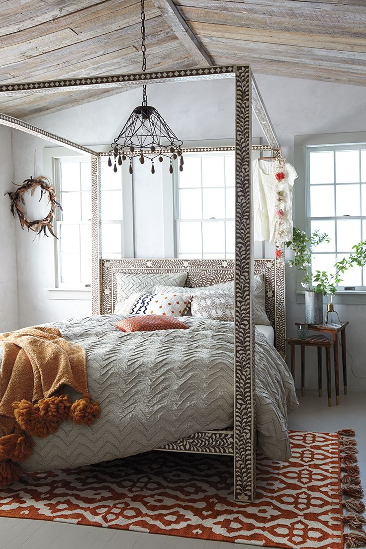 textured chevron duvet bone inlay canopy bed and tasseled rug from anthropologie sidneys dream room
