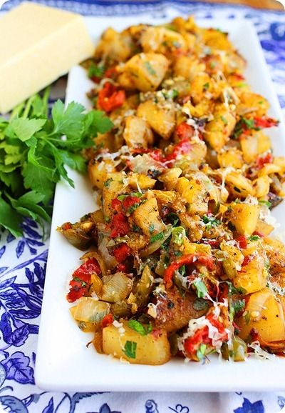 "Potato Hash with Bell Peppers and Onions  Serves 5-6  Printable Recipe     Ingredients   2 Tbsp. olive oil   1 Tbsp. unsalted butter  4 large or 6 medium potatoes, peeled and cut into ½"" cubes   1 onion, diced   1 red bell pepper, diced   2 tsp. fresh parsley, chopped  3 garlic cloves, minced   Salt and pepper, to taste"