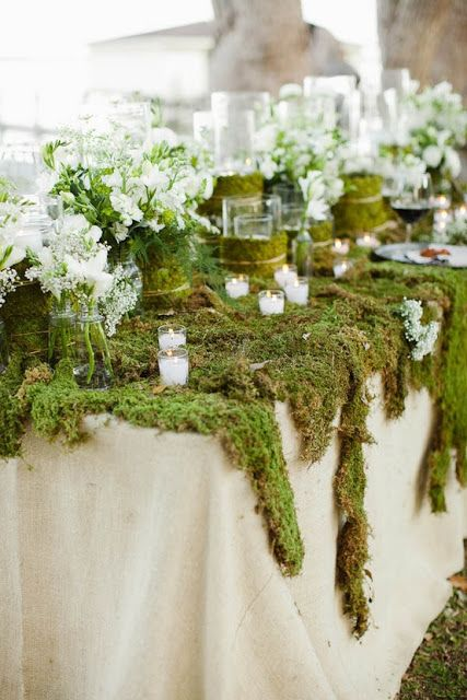The Concrete Cottage: March 2013 moss tablescape with white flowers in jars and votive candle holders trimmed with moss