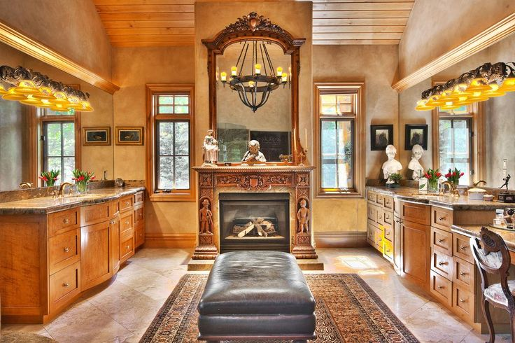 Mediterranean Master Bathroom with Complex Granite, Flat panel cabinets, High ceiling, Wall sconce, Undermount Sink, Flush
