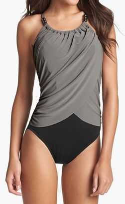 Look 7 pounds slimmer in seconds!® Goddess-like draping flows down the front of a bead-detailed one-piece swimsuit that conceals the tummy as it accentuates curves. http://rstyle.me/n/e5h99nyg6