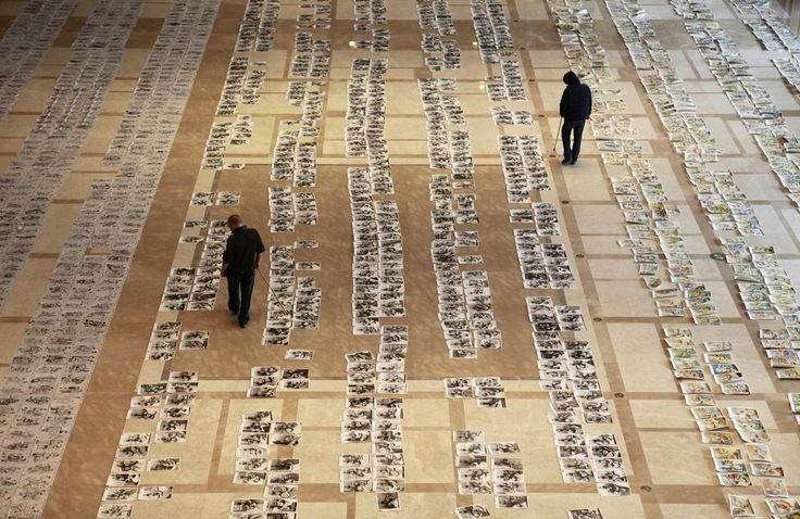 Teachers select and score thousands of paintings, by candidates for the provincial entrance examination for colleges of fine arts, on the ground of a hotel lobby, in Xi'an, Shaanxi province, January 12, 2015. REUTERS/Stringer
