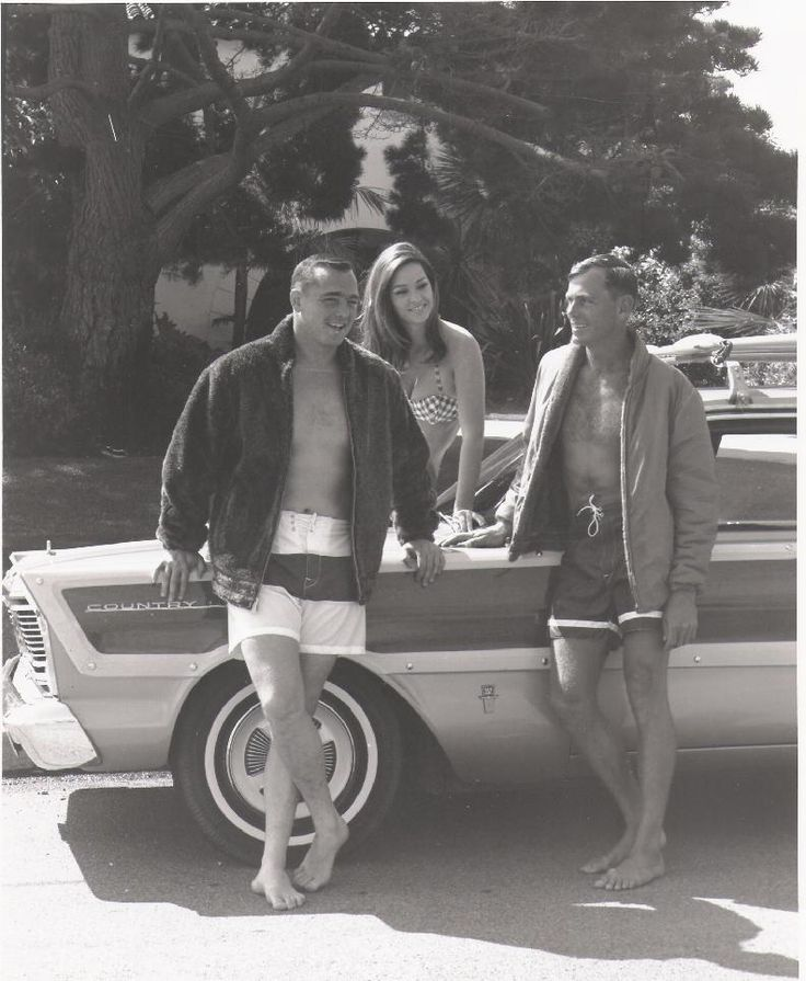 Surfing legends Greg Noll and Phil Edwards with requisite bikini ...