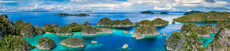 After days of flying boat rides and hikes I got this amazing view of Fam Islands Indonesia [OC] [10000x2240]   landscape Nature Photos