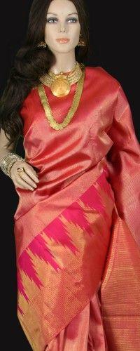 Shimmering gold pink bridal kanjeevaram saree with temple border