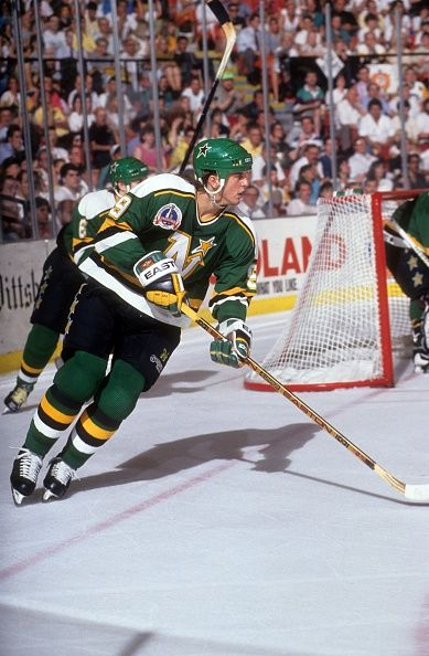 Mike Modano of the Minnesota North Stars skates on the ice during the 1991 Stanley Cup Finals against the Pittsburgh Penguins in May 1991 at the...