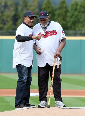 Cavs great Austin Carr, left, gives Browns legend Jim Brown some tips about getting the opening pitch over the plate before the Cleveland Indians home opener. Carr, Brown and Jim Thome threw out the first pitches. (Chuck Crow/The Plain Dealer)