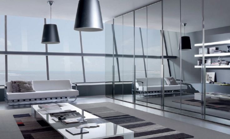 Mirrored Sliding Wardrobes Doors And Black Pendant Lamp Shades Above White Couch Sofa And Large Table