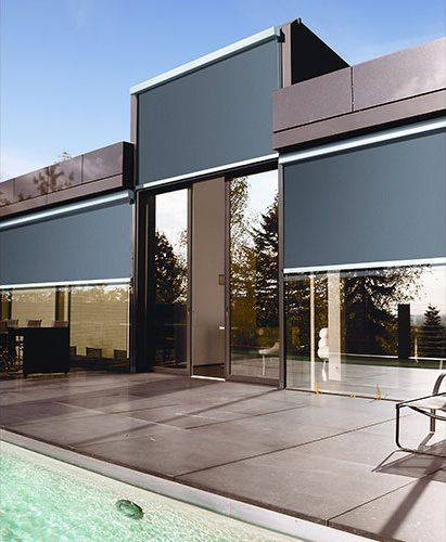 I love these black external blinds, it really matches the modern feel of this house. The stainless steel housing unit looks great with the dark blinds and dark colored stucco. My wife and I would love to find something like this for my parents house. They have a lot of exterior windows, which really heats up the home in the summer time.