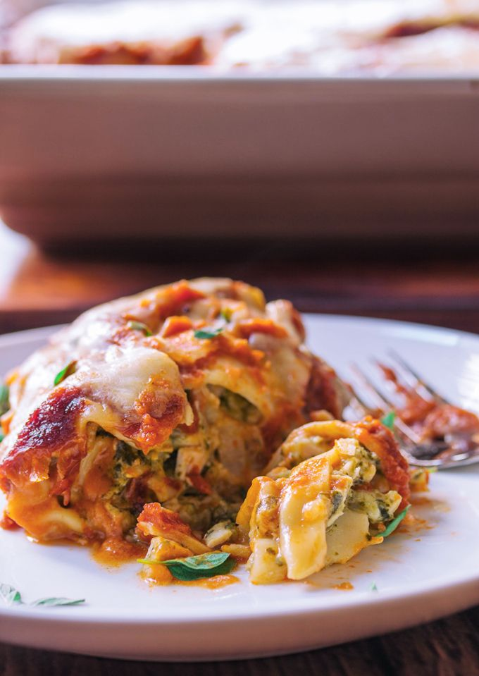 Baked Turkey Pasta Roll Ups with Tomato and Béchamel Sauce - Delicious little bundles of rolled up pasta noodles stuffed with turkey, spinach, and cottage cheese then smothered in a homemade tomato sauce and finished with a creamy béchamel.