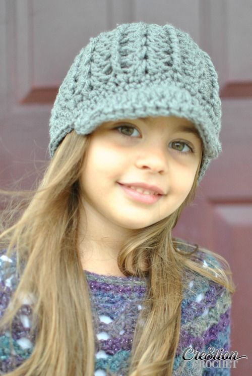 This free crochet newsboy hat pattern is both stylish and trendy. It can also be made in a beanie style by omitting the brim. This hat has interesting architectural features made by the shell/ cluster stitch and the front post double crochet used in the pattern.