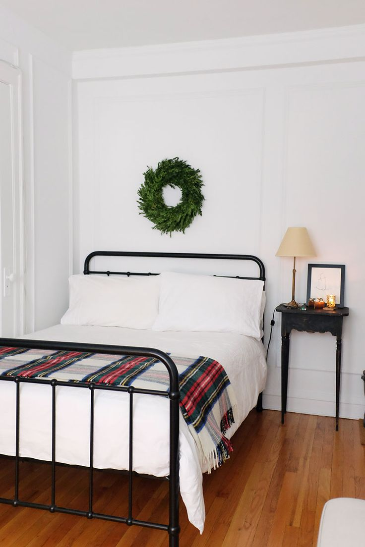 studio apartment | holiday decorating on a budget | studio apartment layout | how to decorate studio apartment | small space decorating | small space decorating for the holidays | small space bed | wreath | nightstand sytling
