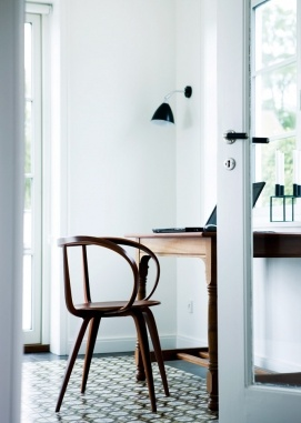 nice office little corner - love the retro floor, chair design, big window door, simple lamp...