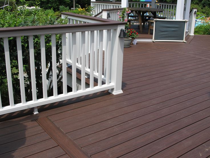 Bergendecks project lava rock with white railings for Composite decking and railing
