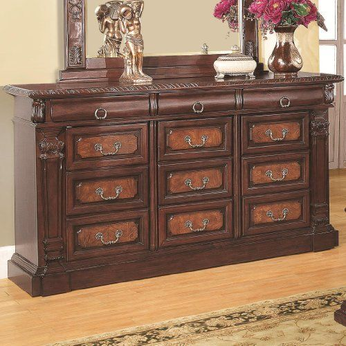St. Paul Dresser by Wildon Home. $1002.04. Pine solids and cherry veneers. Metal on metal glides. Intricate carvings and moldings. Decorative bail handles. Warm brown cherry finish. You'll have plenty of storage space with this drawer dresser in your bedroom decor. The piece carries a warm brown cherry finish and is crafted from beautiful pine solids as well as cherry veneers. In addition, the intricate carvings and moldings add a level of sophistication to the overa...