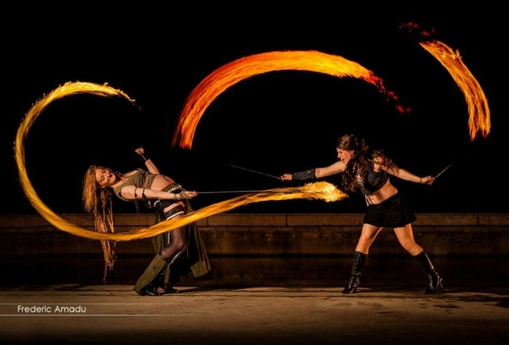 I love this idea of two performers having a battle using fire poi