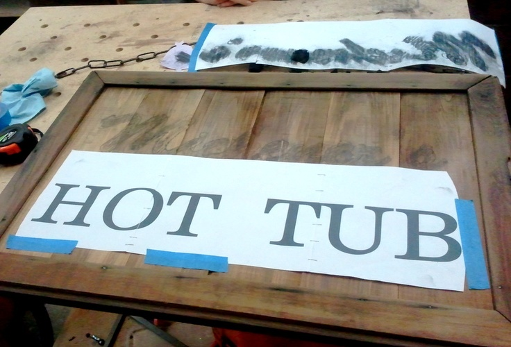 Using charcoal to transfer letters to make a hot tub sign