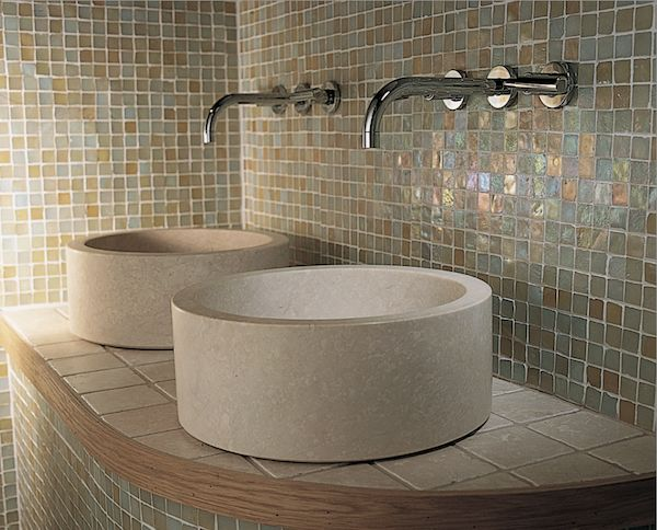 Amazing #tile backsplash behind two cylindrical #stone #bathroom sinks. Gorg!