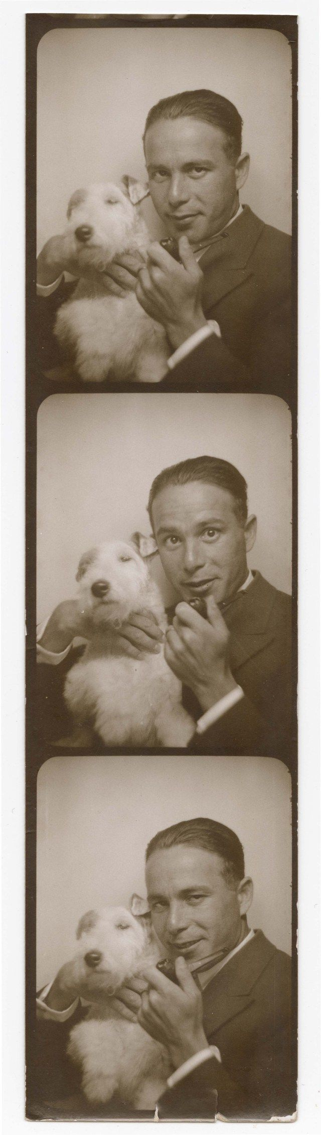 Inventor of the photobooth!! Anatol Josepho with a pipe and terrier, 1920s.