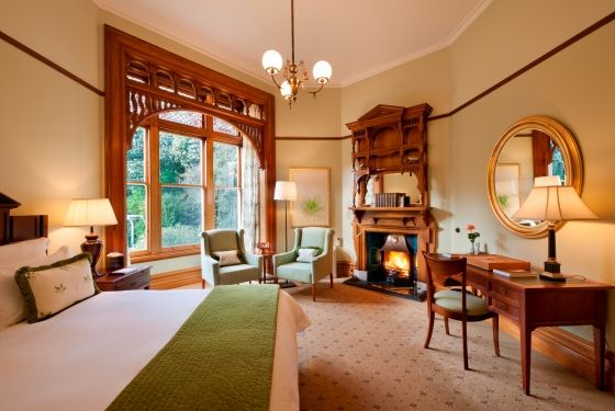 Otahuna Lodge is an intimate, exclusive retreat offering seven individual suites within an 1895 homestead. With stunning interior decor including ornate wood-burning fireplaces, carved inglenooks and stained glass windows