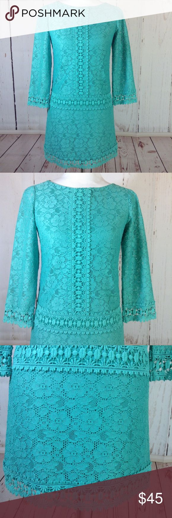 "Laundry by Shelli Segal Turquoise Lace Dress Sz 2 Laundry by Shelli Segal Size 2 Sheath Dress Turqouise Floral Lace Long Sleeve Fully lined Sheer sleeves Keyhole back with hidden zipper  Shown on a medium size mannequin  Approximate flat measurements:  Chest: 16.5"" Shoulders: 14"" Waist: 16"" Hips: 17.5 Length from top of shoulder to hem down back: 31.5"" Arm length: 18"" Laundry By Shelli Segal Dresses Long Sleeve"