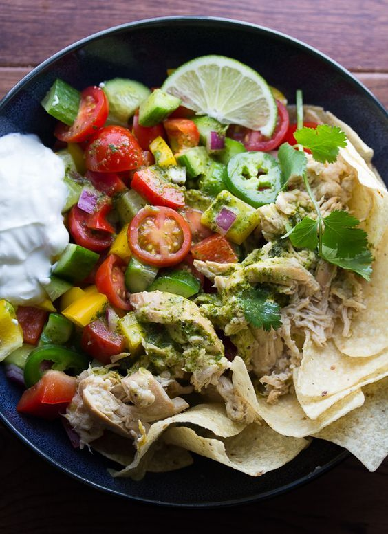 Get your slow cookers running this summer and make pulled beer chicken to top a healthy and delicious taco salad.  Then toss the whole thing in a fresh cilantro vinaigrette!  The perfect, easy dinner!: