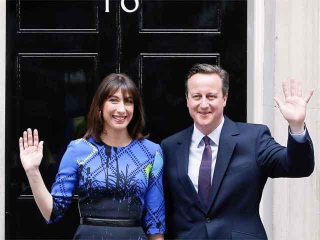 Slideshow : David Cameron with his wife Samantha after winning - Defining images of British Elections 2015 - The Economic Times